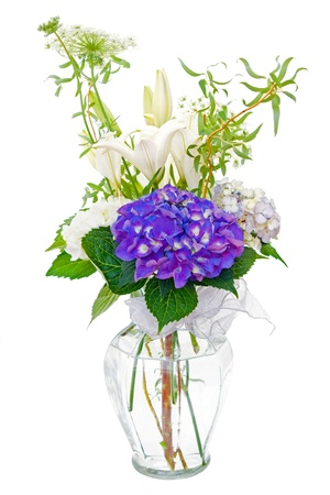 Hydrangea and lily sympathy flower bouquet in vase isolated on white  photo