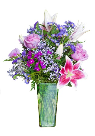 Colorful flower bouquet in vase isolated on white.  photo