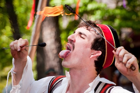 atlanta tourism: Atlanta, Georgia, USA - May 21, 2011 - A performer eats fire at the annual Renaissance Festival in Atlanta. The festival is a popular annual tourist attraction in the Southeast.