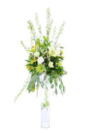 Large wedding flower arrangement with roses, lilly, mum, spider chrysanthemum and carnation isolated on white