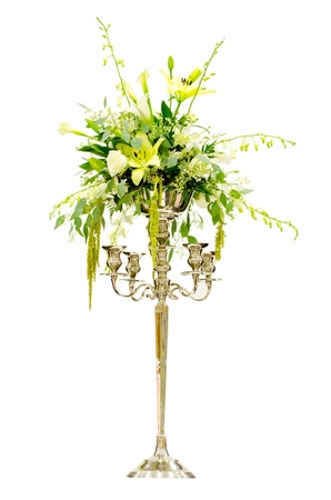 Wedding flower arrangement centerpiece with orchid, rose, lily, calla lily on Victorian candelabra isolated on white