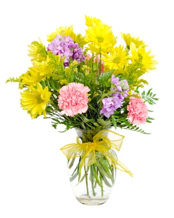 alstromeria: Colorful flower arrangement centerpiece in glass vase with carnations, daisies isolated on white  Stock Photo