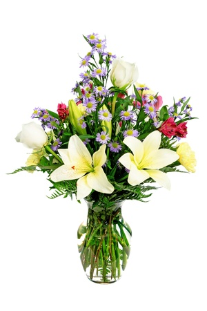 alstromeria: Colorful flower arrangement centerpiece in glass vase with roses, daisies and lilies isolated on white