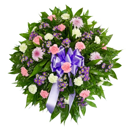 flower arrangements: Colorful flower arrangement wreath for funerals isolated on white  Stock Photo