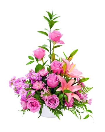 Colorful purple flower arrangement centerpiece with roses, lily, carnations, isolated on white.  photo