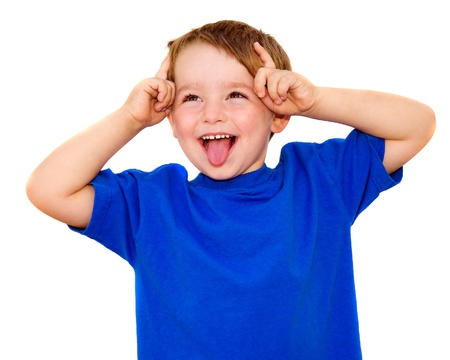 cheeky: Kid making funny expression isolated on white