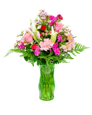 alstromeria: Fresh, colorful professional flower arrangement in green glass vase isolated on white