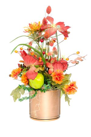 Fall color silk flower arrangement in pail Stock Photo