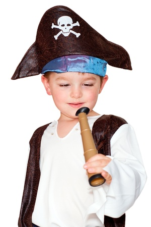 Cute young boy playing with pirate costume for Halloween isolated on white