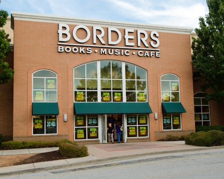 retailer: DOUGLASVILLE, GA-JULY 30:Customers enter a Borders store in Douglasville, GA, on July 30, 2011. Borders, the nations second largest book retailer is in bankruptcy and closing its remaining 399 stores