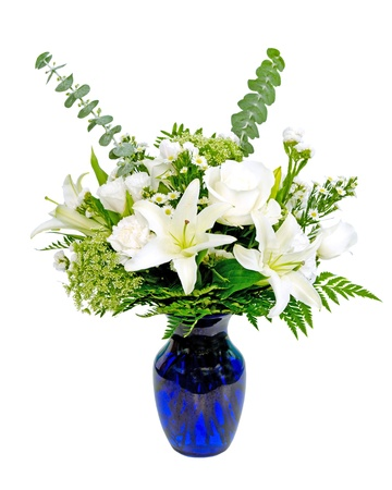 flower vase: White and green flower arrangement centerpiece in blue vase with lilies isolated on white
