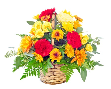 Flower arrangement with fall color carnations and daisies in basket  photo