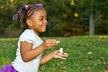 Young African-American girl playing in park photo