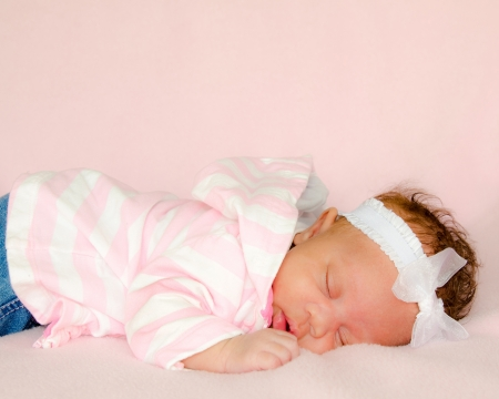 mixed race ethnicity: Portrait of African-American infant baby girl sleeping in image with copy space