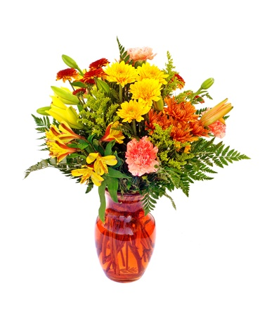 Fresh fall color flower arrangement in orange vase isolated on white