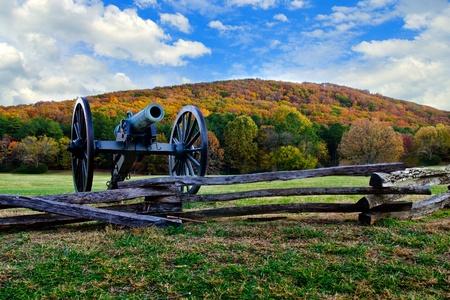 Civil War era cannon overlooks Kennesaw Mountain National Battlefield Park during fall or autumn