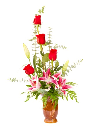 Flower arrangement with lily and roses isolated on white