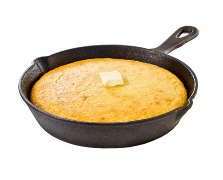 cornbread: Corn bread in iron skillet isolated on white