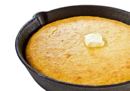 cornbread: Close up of cornbread in iron skillet isolated on white Stock Photo