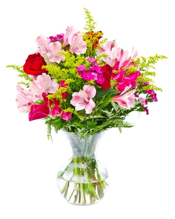 floral arrangement: Colorful flower bouquet arrangement centerpiece in vase isolated on white. Stock Photo