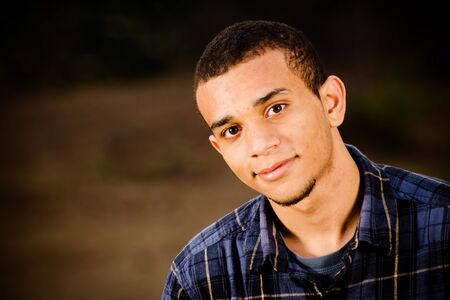 Portrait of African-American teenager outdoors at park  photo