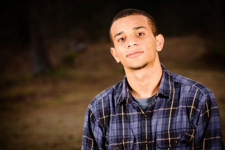 grunge teenager: Portrait of African-American teenager outdoors at park