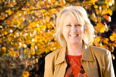 beautiful middle aged woman: Fall portrait of happy middle-aged blonde woman