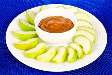 dulce de leche: Green Apple Slices y Dip Caramel Apple Foto de archivo