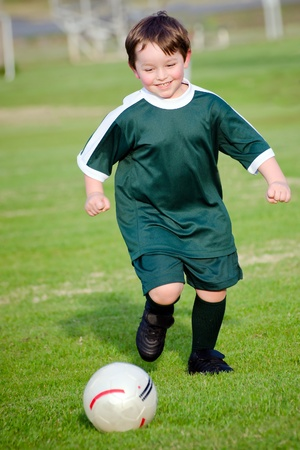 Young boy playing soccer photo