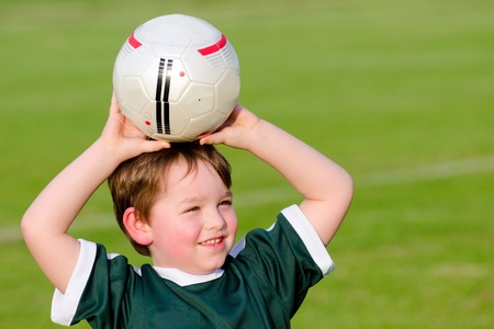 run down: Young boy playing soccer Stock Photo