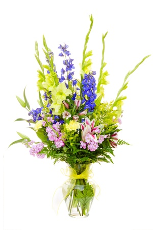 Large colorful flower arrangement with gladiolus, lilly, carnation, rose, delphinium isolated on white