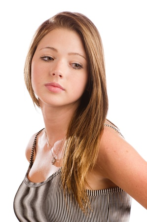 Portrait of beautiful teenage girl with serious expression isolated on white with space for copy