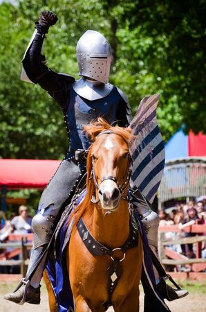 ATLANTA - APRIL 23:Knight in action during the annual Renaissance Festival in Atlanta on April 23, 2012. The festival is a popular annual tourist attraction in the Southeast