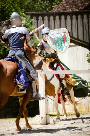 ATLANTA - APRIL 23:Knights joust during the annual Renaissance Festival in Atlanta on April 23, 2012. The festival is a popular annual tourist attraction in the Southeast Stock Photo - 13289606
