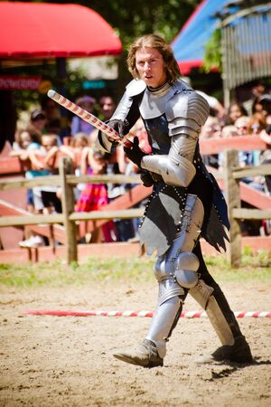 ATLANTA - APRIL 23:Knight in action during the annual Renaissance Festival in Atlanta on April 23, 2012. The festival is a popular annual tourist attraction in the Southeast Stock Photo - 13289611