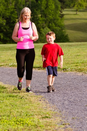 Mother and son jogging for exercise outdoors photo
