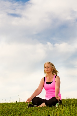 Middle-aged woman in her 40s meditating for exercise outdoors Stock Photo - 13340641