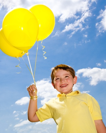 Happy child with balloons photo