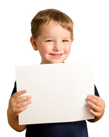 preteen boys: Cute young happy preschooler boy holding up blank sign with room for copy isolated on white