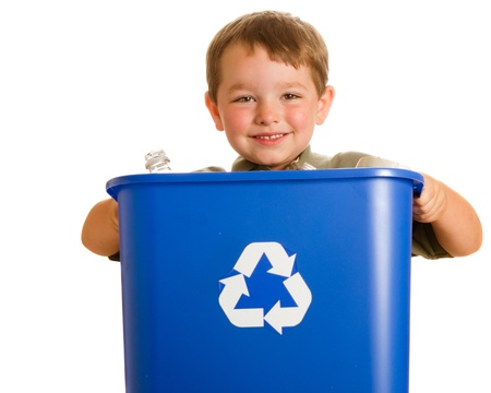 Recycling concept with young child carrying recycling bin isolated on white photo