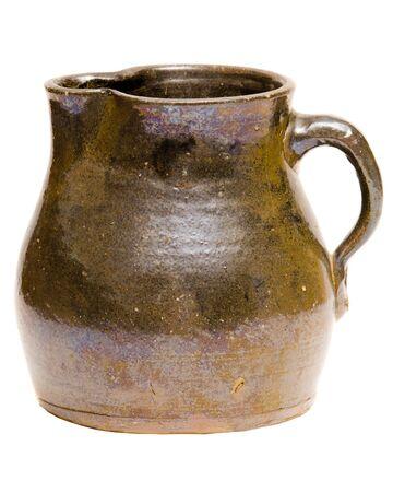 a jar stand: Antique Depression-era clay pitcher