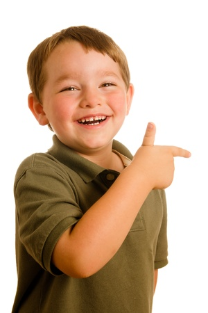 Portrait of young boy child pointing a direction isolated on white Foto de archivo