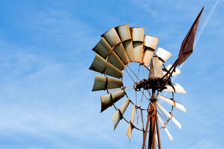 mechanical energy: Old rusty windmill at rural farm