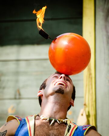 ATLANTA - MAY 20: Performer doing a stunt at the annual Renaissance Festival in Atlanta on May 20, 2012. The festival is a popular annual tourist attraction in the Southeast. Stock Photo - 13692327