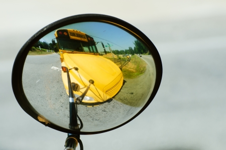 School bus reflected in its own wide angle safety mirror photo