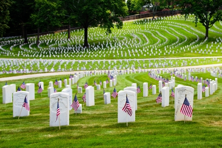 MARIETTA, GA - MAY 26: U.S. flags decorate veterans graves on May 26, 2012, for Memorial Day at the National Cemetery in Marietta, Ga. More than 17,500 war veterans are buried at the cemetery.