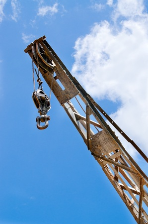 venues: Block and tackle, ball and hook on industrial crane