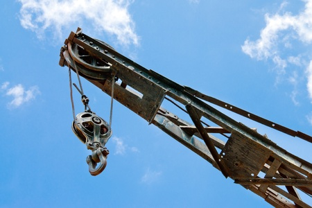 slings: Block and tackle, ball and hook on industrial crane