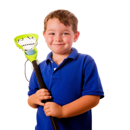 lacrosse: Child lacrosse player with his stick and ball isolated on white