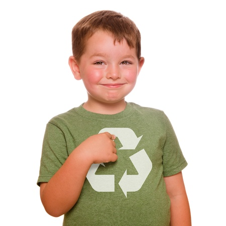 Recycling for the future concept with smiling child proudly pointing at recycling logo on his green t-shirt photo